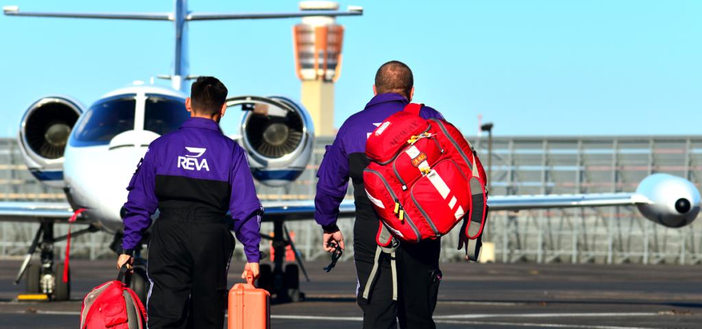 air ambulance crew walking towards plane